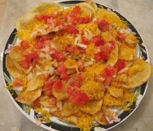 cheesy potatoes (cheddar, potato crisps, onions and tomatoes)