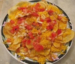 cheesy potatoes (cheddar, potato crisps, onions and tomatoes)