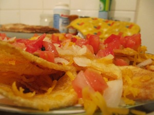 cheesy potatoes (cheddar, fried potatoes, onions and tomatoes)